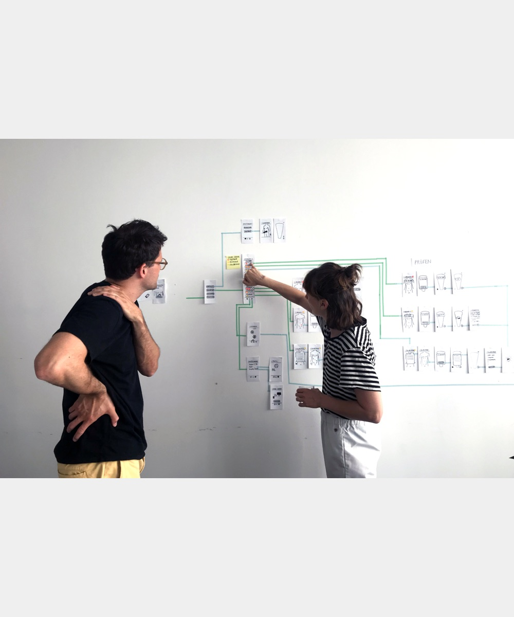 Two team members develop on the whiteboard